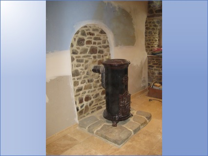 wood burner, stone plinth,travertine til