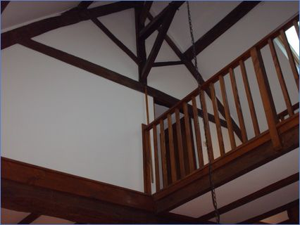 finished barn ceiling with exposed beams